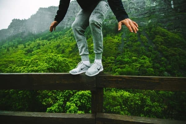 jumping off wooden railing