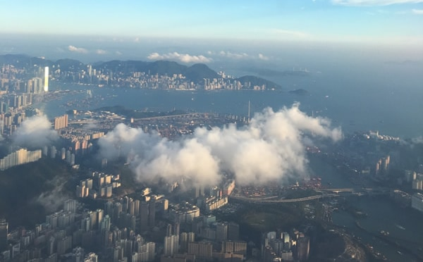 dragon appearing in a cloud over Hong Kong