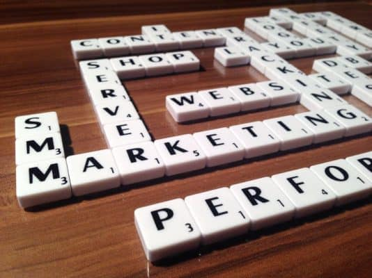 scrabble board with marketing words