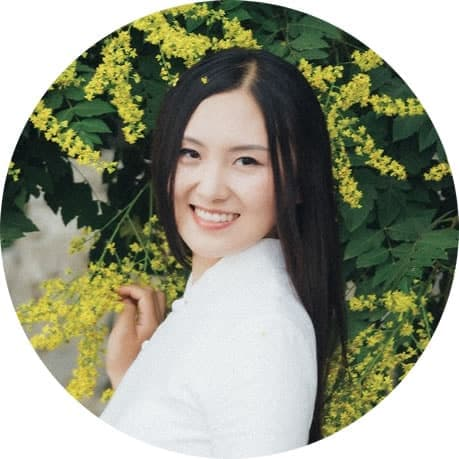Queena-Qu Huang in round frame with yellow flowers