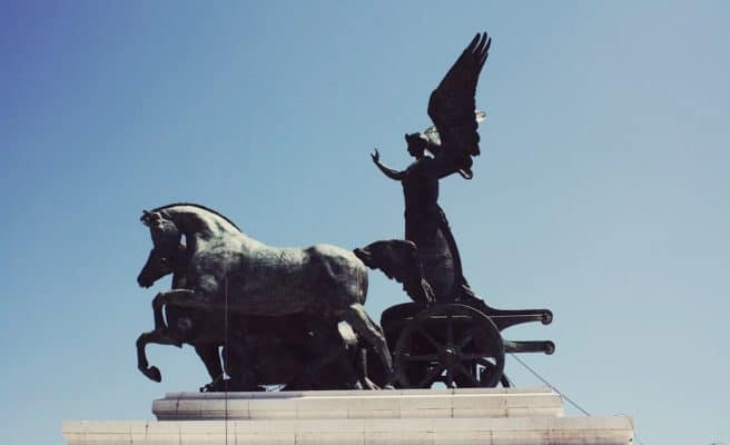 chariot horse angel statue with blue sky